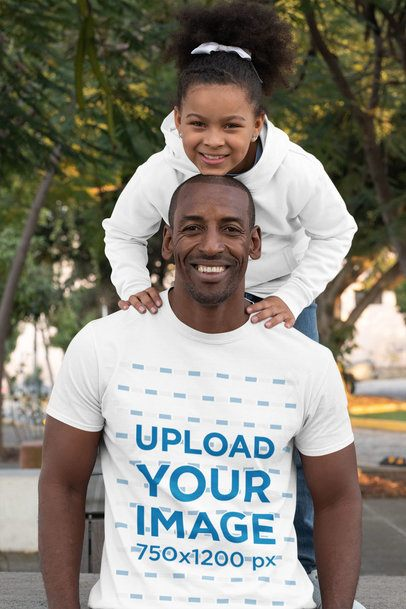 T-Shirt Mockup Featuring a Happy Dad and His Daughter Posing at a Park 31393
