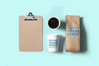 Mockup of a Coffee Cup and a Paper Bag Placed over a Flat Surface 2629-el1