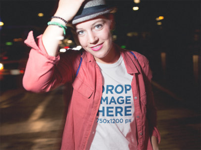 Mockup of a Stylish Woman Wearing a Tee and Hat Out at Night a11802