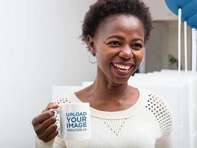 Mockup of a Woman Holding an 11 oz Coffee Mug at an Office 31906