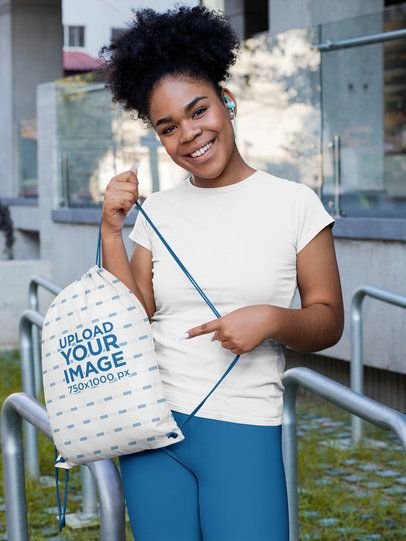 Mockup of a Woman Pointing at Her Drawstring Bag 31340