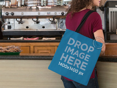 Tote Bag Mockup of a Woman at a Coffee Shop a11574