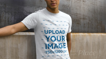 Video of a Man Wearing a T-Shirt and Posing Against a Concrete Wall 32020