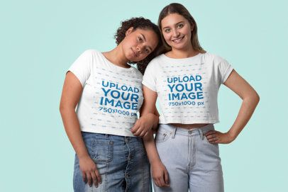 Crop Top Mockup Featuring Two Women Standing Close at a Studio 31978