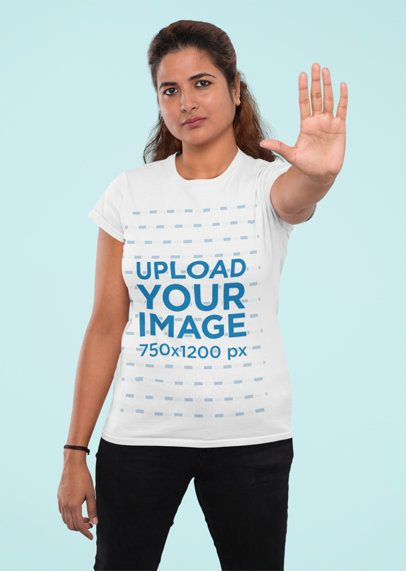 T-Shirt Mockup Featuring a Woman Doing a Halt Sign with Her Hand 31953