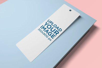 Mockup of a Bookmark on Top of a Color-Custom Book 2658-el1