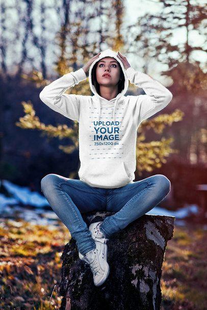 Hoodie Mockup of a Woman Sitting on a Tree Stump 2780-el1