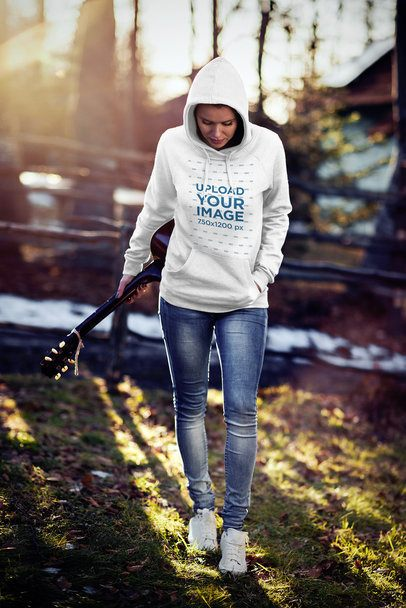 Pullover Hoodie Mockup of a Woman Carrying a Guitar 2783-el1