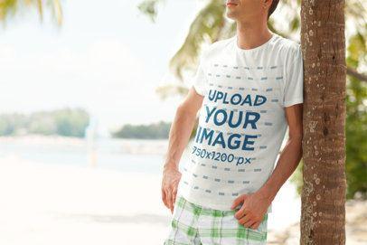 Crewneck T-Shirt Mockup of a Man Leaning on a Palm Tree 2754-el1