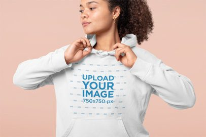 Studio Mockup of a Woman Grabbing Her Pullover Hoodie 32001
