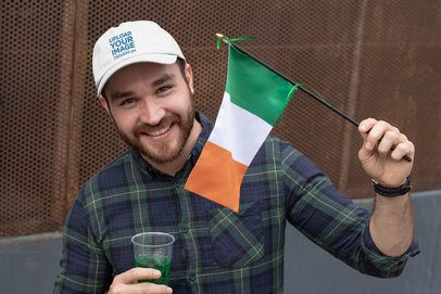 St. Patrick's Day Mockup of a Smiling Man Holding an Ireland Flag 32127
