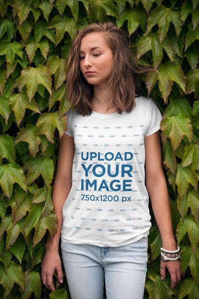 T-Shirt Mockup of a Young Woman Leaning on a Wall of Ivy 2761-el1