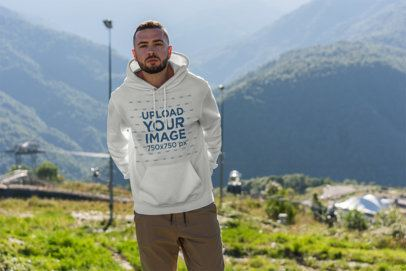 Mockup of a Man Wearing a Hoodie at The Mountains 2771-el1