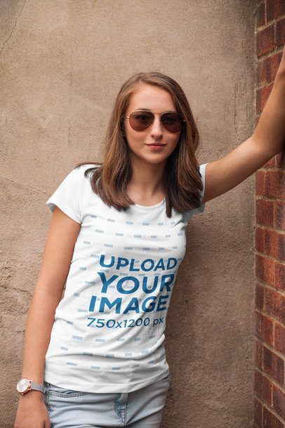 Mockup of a Woman with a Tee Leaning on a Brick Wall 2763-el1