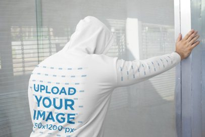 Back View Mockup of a Man Wearing a Hoodie with a Customizable Sleeve 31487