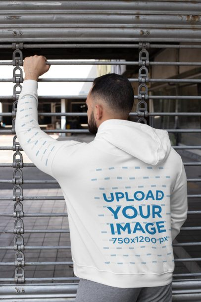 Back-View Mockup of a Man Wearing a Hoodie with a Customizable Sleeve 31488