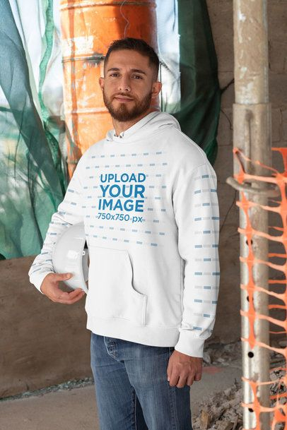 Pullover Hoodie Mockup of a Man Holding a Safety Helmet 31539