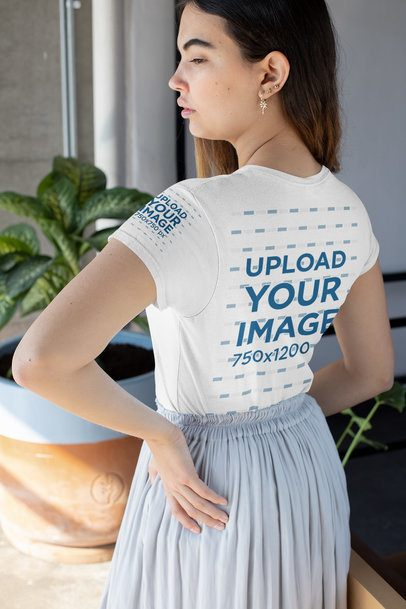 Back View Mockup of a Woman Wearing a T-Shirt with a Customizable Sleeve and a Skirt 31460