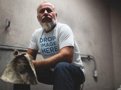 T-Shirt Mockup of a Senior Man Crouching in a Garage a12061