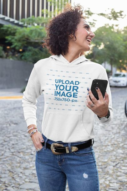Hoodie Mockup Featuring a Woman Walking Down the Street 31617