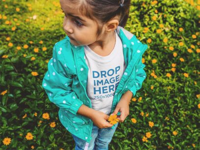 T-Shirt Mockup of a Little Girl Picking Flowers a12105