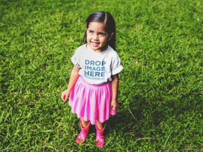 Round Neck Tee Mockup of a Little Girl in a Pink Skirt a12101
