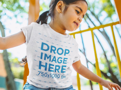 Little Girl Playing at the Jungle Gym T-Shirt Mockup a12107