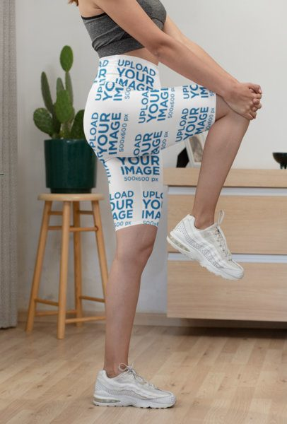 Cropped Face Mockup of a Woman with Bike Shorts Stretching Out 31527