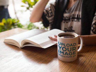 Coffee Mug Mockup of a Woman Reading a Book a11946