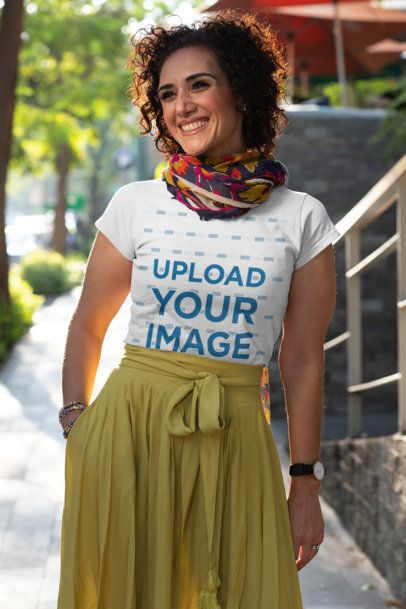 T-Shirt Mockup Featuring a Joyful Middle-Aged Woman Walking down the Street 31624