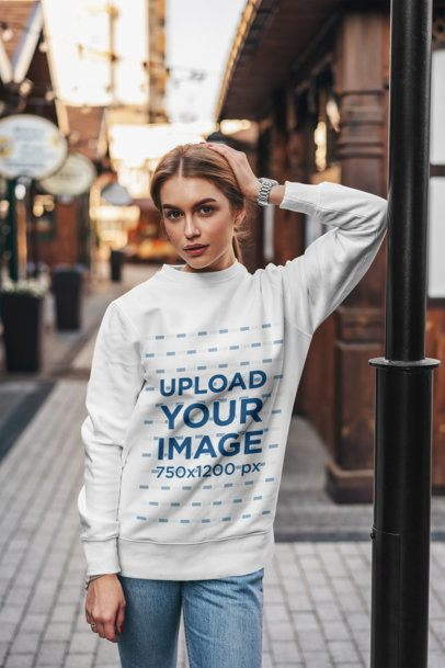Mockup of a Woman with a Crewneck Sweatshirt Posing on the Street 2829-el1
