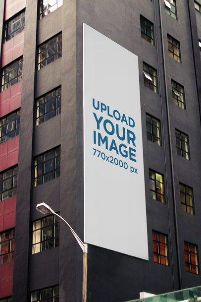 Mockup of a Vertical Billboard on a Gray Modern Building 2869-el1
