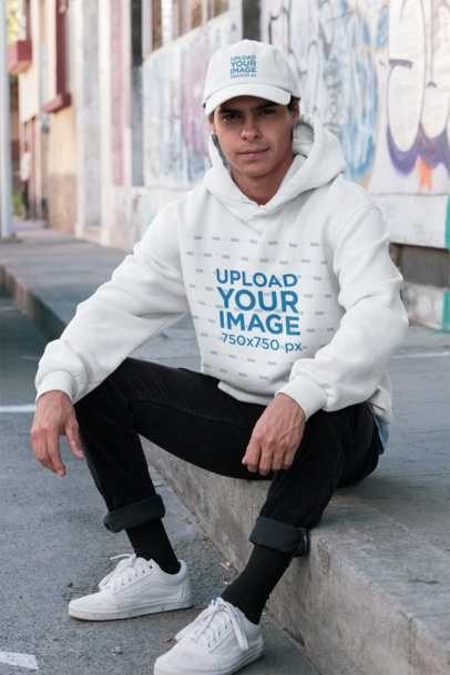 Hoodie Mockup Featuring a Young Man Wearing a Dad Hat 31170