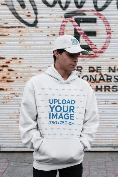 Pullover Hoodie Mockup Featuring a Man with a Dad Hat at an Urban Scenario 31177