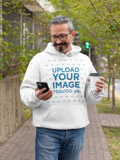 Hoodie Mockup of a Silver-Haired Man Staring at His Phone 31724