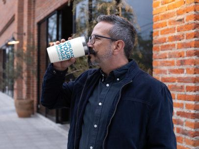 Mockup of a Bearded Man Drinking From a Travel Mug 31725
