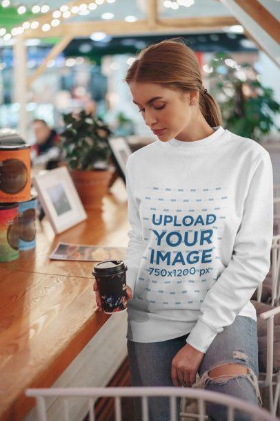 Crewneck Sweatshirt Mockup of a Woman Posing by a Coffee Shop Counter 2838-el1