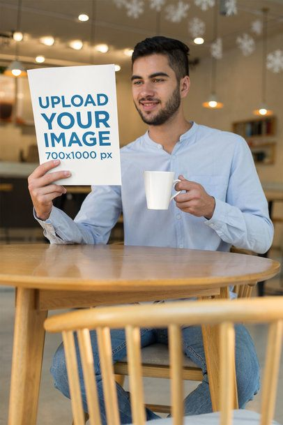 Mockup of a Smiling Man Reading a Magazine at a Cafe 31549