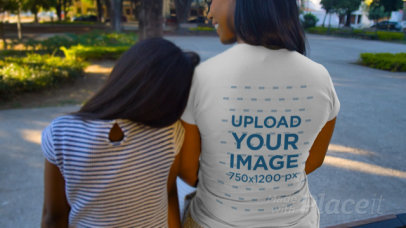 T-Shirt Video of a Girl and Her Mother Sitting at a Park 32343
