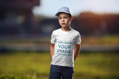 T-Shirt Mockup Featuring a Boy Standing Against a Blurry Background 2920-el1