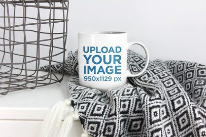 Mockup of a Coffee Mug Placed Over a Blanket 2947-el1