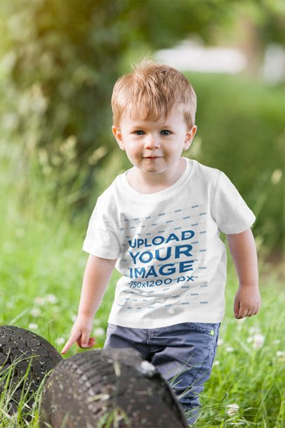 T-Shirt Mockup of a Little Boy Playing in Nature 2916-el1