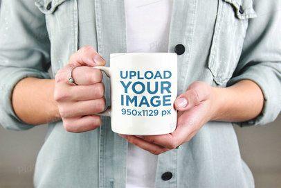 Mockup of a Woman Holding Her Coffee Mug 2949-el1
