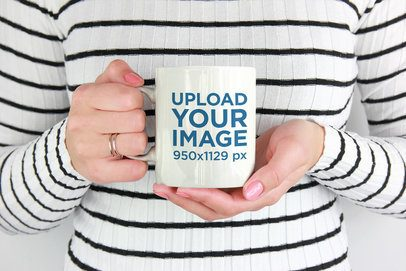 Mockup of a Woman Wearing Stripes Holding an 11 oz Mug 2952-el1