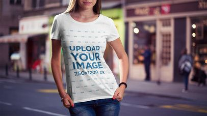 Mockup of a Woman Showing off Her T-Shirt on the Street 2989-el1