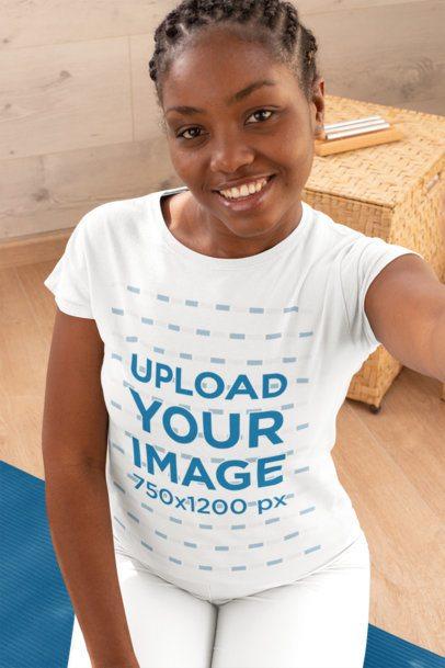 Selfie Mockup of a Woman Wearing a T-Shirt at a Yoga Studio 31094