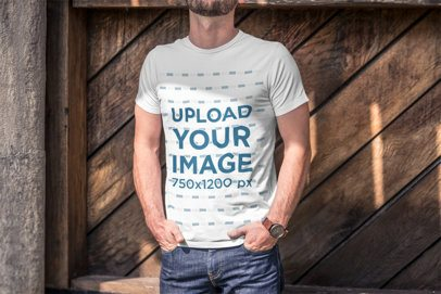 T-Shirt Mockup Featuring a Cropped-Face Man with Hands in His Pockets 2967-el1