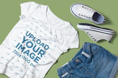 T-Shirt Mockup Featuring a Girl's Outfit Placed on a Plain Color Surface 2994-el1