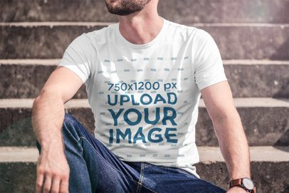 T-Shirt Mockup of a Bearded Man Sitting on Some Steps 2968-el1