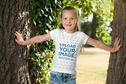 T-Shirt Mockup of a Little Girl Playing in the Woods 2908-el1